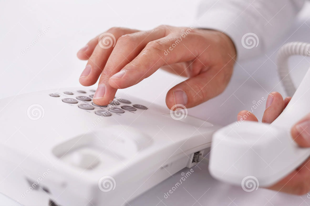 man-making-telephone-call-landline-close-up-view-hands-holding-handset-close-to-camera-dialling-33910516